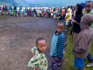 Newly arrived refugees from the Democratic Republic of Congo queue at the Nakamira transit camp near Gisenyi in northwest Rwanda after fleeing the Masisi region in Congo's North Kivu province