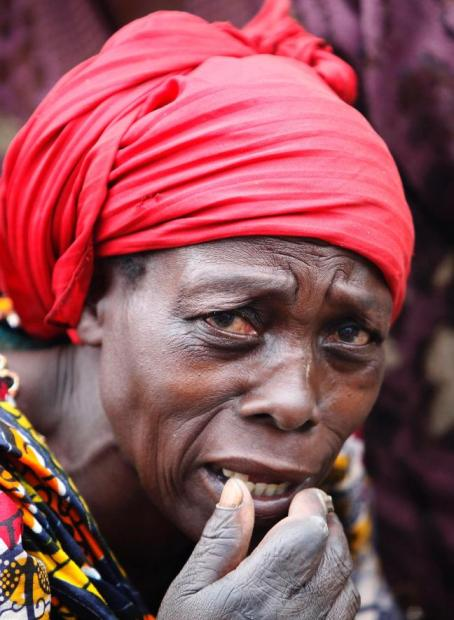 A refugee from the Democratic Republic of Congo reacts to camera as she arrives at the Nyakabande refugee transit camp in Kisoro town 521km (312 miles) southwest of Uganda capital Kampala (REUTERS/James Akena)