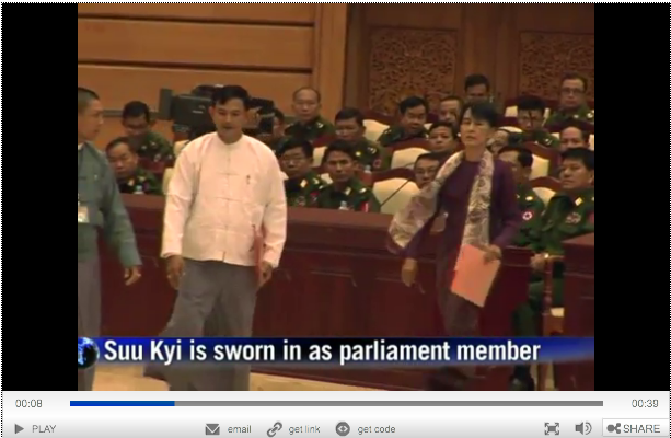Suu Kyi joins parliament