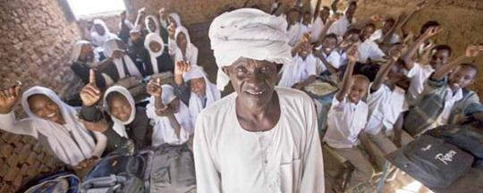 A proud teacher with his class in Central Darfur